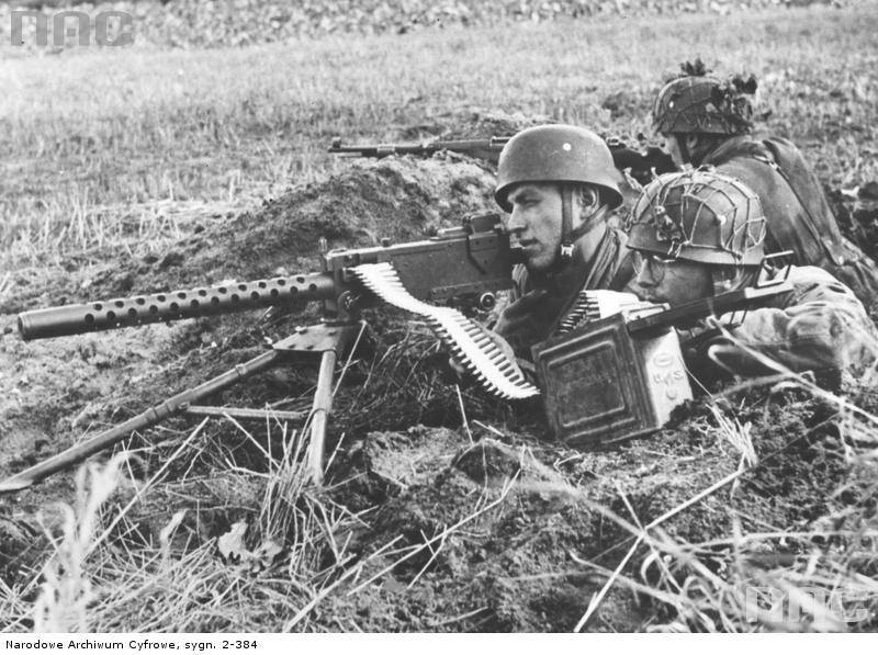 German paratroopers firing a captured U.S. M1919A4 Browning machine gun..jpg