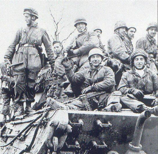 Ardennes Offensive, Fallschirmjäger on left with British Sten gun..jpg